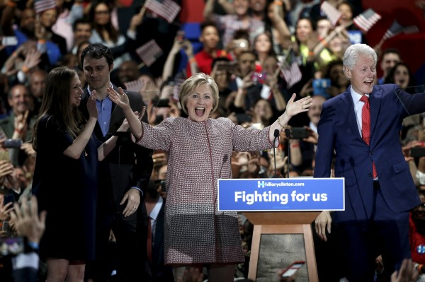 U.S. Democratic presidential candidate Hillary Clinton reacts to the cheers of the crowd as she arrives onstage with her husband, former U.S. President Bill Clinton, at her New York presidential primary night rally in the Manhattan borough of New York City, U.S., April 19, 2016.