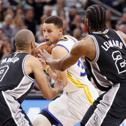 Warriors hold off Mavs for third straight win