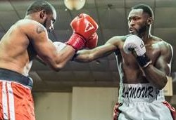 Russell Lamour Jr. (right) of Portland throws a sharp right to Borngod Washington of Queens, New York, during their bout Saturday night at Rockingham Park in Salem, New Hampshire.