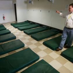 Josh O'Brien, director of Portland's Oxford Street Shelter, counts mats on the floor at the facility Wednesday Dec. 12, 2012 during his daily walk through. O'Brien is receiving the city's Robert B. Ganley Public Service Award for his tireless efforts to help the homeless.
