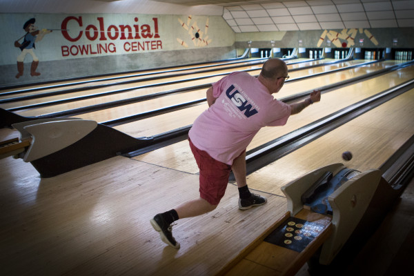 Jerry Sparks rolls a candlepin bowling ball down the lane on Monday night at Colonial Bowling Center in Westbrook. The bowling alley will close for good after a farewell tournament May 7.