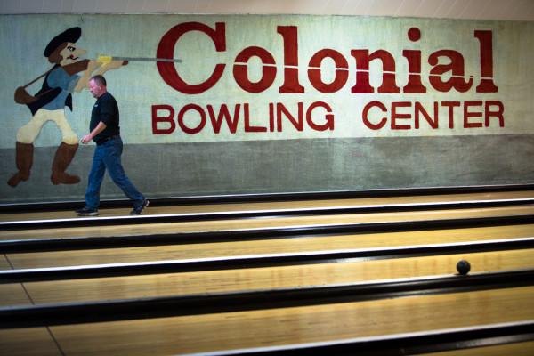 Kevin Sparks, owner of Colonial Bowling Center, walks down a lane Monday night at the bowling alley in Westbrook. The bowling alley will close for good after a farewell tournament May 7.