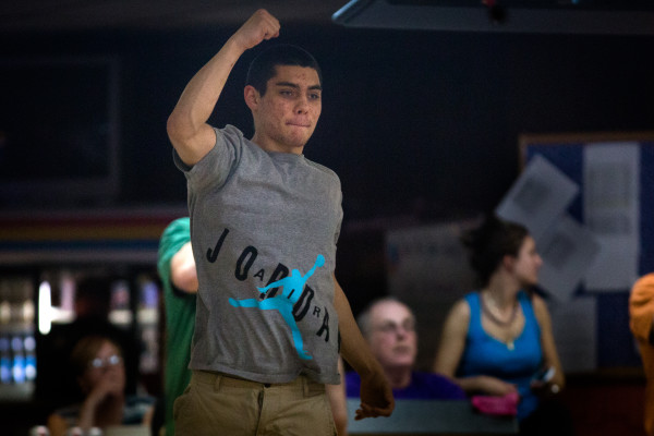 Jordan Sparks celebrates a fine shot Monday night at Colonial Bowling Center in Westbrook. The bowling alley will close for good after a farewell tournament May 7.