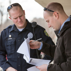 Officer Dustin Dow (left) of the Bangor Police Department and Detective Jeremy Brock perform sex offender registry compliance checks on a recent afternoon in Bangor.
