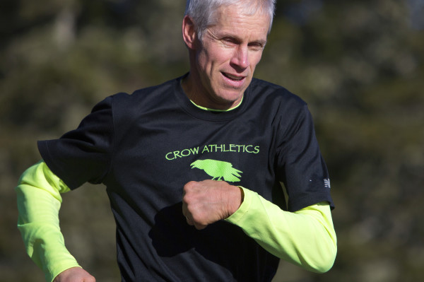 Michael Westphal goes for a short run on the one main road on Great Cranberry Island Wednesday in preparation for the Boston Marathon. Westphal has Parkinson's disease but hasn't let that stop his love for running.