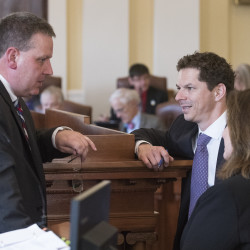 Maine Senate President Michael Thibodeau (from left), Senate Minority Leader Justin Alfond and Assistant Senate Minority Leader Dawn Hill talk  on the last day of the 127th Legislature on Friday at the State House.