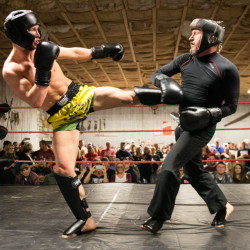 Josh Harvey (left) throws a kick against Stacy Lupo on Friday night during an amateur sparring event at the Factory One nightclub in Dexter.