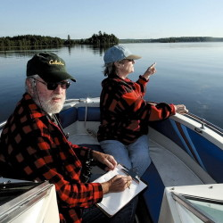 Citizen scientists Will Reid and Barbara Wyman take part in a past loon count for Maine Audubon on Wesserunsett Lake.
