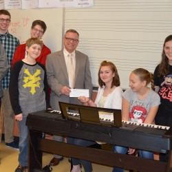 Left to Right, Front row: Cameron Roy; Ben Thibault; Don Lauzier, of SBSI; Sarah Alrefai; Kaylee Perron and Emma Rousseau; Second row: Michael Delorge and Amy Delorge, Band Director at Biddeford Middle School
