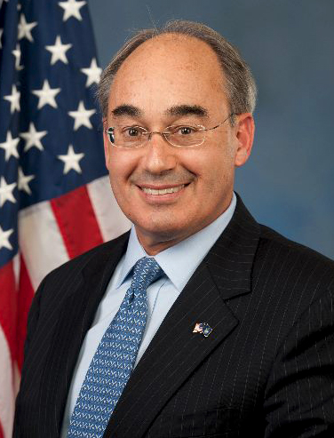 Poliquin tackles all in partisan blog