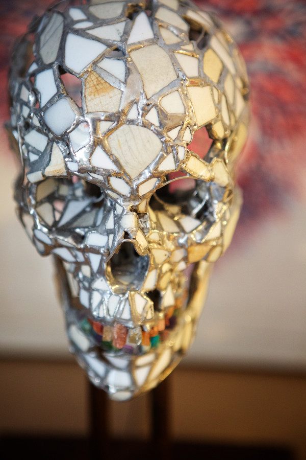 A skull made from glass and found objects sits in artist Mike Libby's Portland studio, where he also makes his Insect Lab creations.