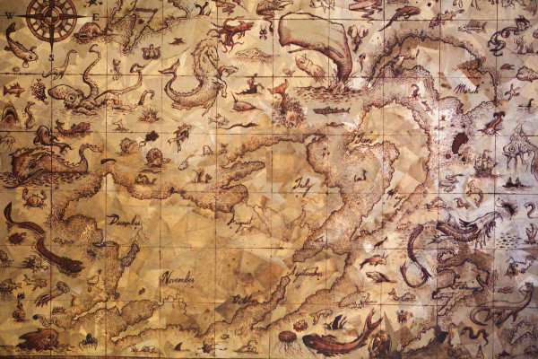 A fanciful map, painted with coffee, featuring all manner of monsters and mythical creatures, hangs on the wall in Mike Libby's Portland studio.
