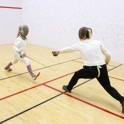 Erin Gerbi (left) fences saber with her father, Chris Gerbi, at the New Balance Recreational Center in Orono on Wednesday. Erin, who just turned 13, has qualified for the Summer Nationals of the U.S. Fencing Association and is the only youth saber fencer in the state to qualify.