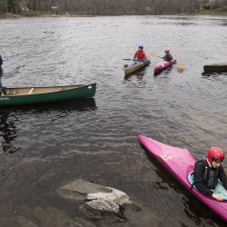 Jeff Owen (left) waits for kids to get ready before paddling into the faster current of the Stillwater River in Orono on Wednesday. Owen teaches wildwater kayaking and canoeing skills to kids in the Orono area.
