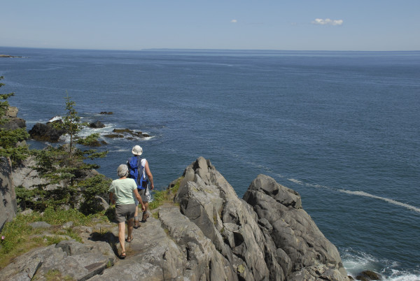 After hiking more than a mile through a thick spruce-fir forest, two hikers emerge onto the jagged gray granite cliffs of the Bold Coast Trail inside the Cutler Coast Public Preserve Land in this August 2009 file photo.