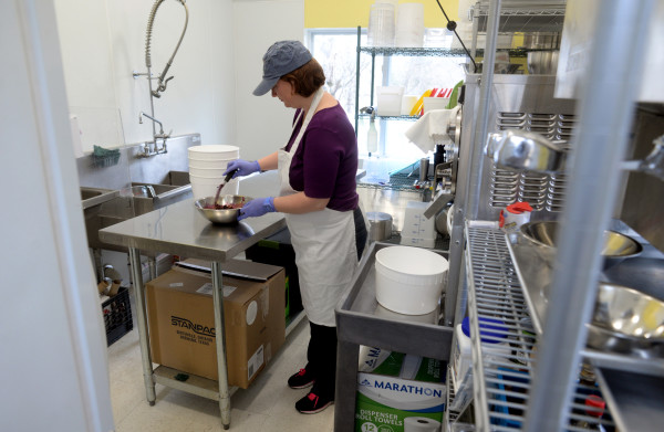 Sarah Wilder of Wild Cow Creamery mixes up blueberries and crumble for a batch of blueberry crumble ice cream on Monday.
