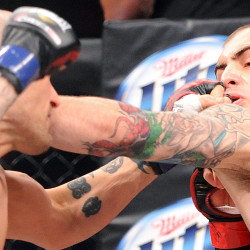 Jon Lemke (left) of Bangor delivers a left to the face of Auburn's Jesse Erickson during their Bellator MMA fight at the Androscoggin Bank Colisee in Lewiston in this March 2013 file photo.
