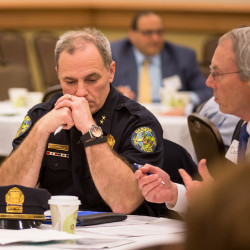 Bangor Police Chief Mark Hathaway listens to The Acadia Hospital President Dan Coffey discuss the opiate epidemic during the One Life Project at the Cross Insurance Center in Bangor on Wednesday, May 4.