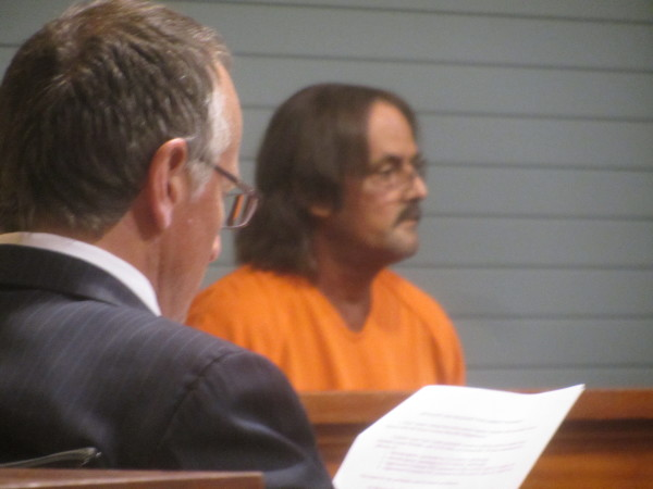 Randall Junior Weddle, 54, of Greeneville, Tennessee made his initial appearance in a Maine court Monday morning on two counts of manslaughter and two counts of aggravated operating under the influence. His attorney, David Paris, sits reading the court documents before the hearing.