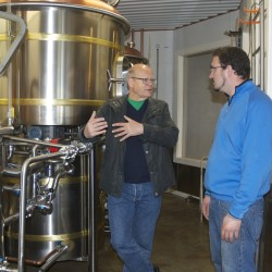 Joseph Gervais (right), executive chef at the soon-to-open Northern Maine Brewing Co., talks beer with master brewer Vincent Fleck, designer of the brewing equipment used to create the uniquely Aroostook County craft beers.