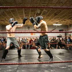 Jimmy Jackson (left) of Young's MMA in Bangor and Colby Hakkila of the Choi Institute in Portland compete in a kickboxing bout during an amateur sparring event at the Factory One nightclub in Dexter, April 1, 2016. The event, a fundraiser for the Maine Veterans' Fund, was believed to be the first of its kind in Maine.