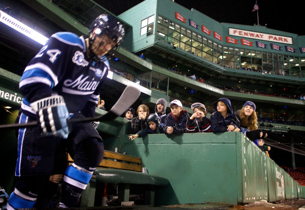 Senior Mark Anthoine of the University of Maine climbs out of the tunnel at Frozen Fenway in Boston for the start of the third period against Boston University, Jan. 11, 2014. The Maine Black Bears went on to win by a score of 7-3.