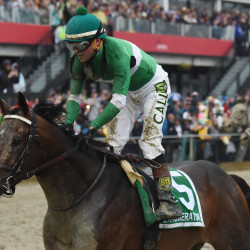 Kent Desormeaux aboard Exaggerator (5) wins during the 141st running of the Preakness Stakes Saturday at Pimlico Race Course in Baltimore.