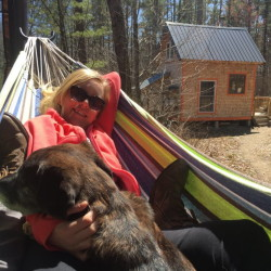 Liz Crawford of Boone, North Carolina, relaxes in a hammock at Lon Cameron's tiny house Airbnb.