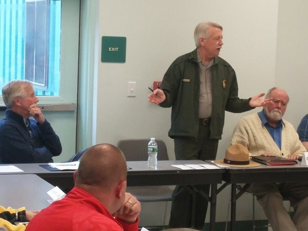 National Park Service Director Jonathan B. Jarvis addresses the crowd at the Katahdin Region Higher Education Center in East Millinocket Monday. Jarvis is listening to Maine people's opinions on a proposed National Monument in the region. U.S. Sen. Angus King (left) listens.