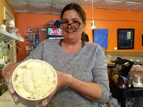 Jenny Siler, owner of Little Bee Honey Ice Cream with her favorite flavor ginger. She makes small batches in the back of Black Cat Cafe.
