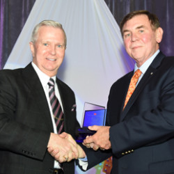 Richard Dupuis, Outgoing Chair of the Maine CU League's Awards & Convention Committee, presents the Alexander Ferguson Award for Outstanding CU Volunteer to John Doe, Vice Chair at Eastmill FCU.