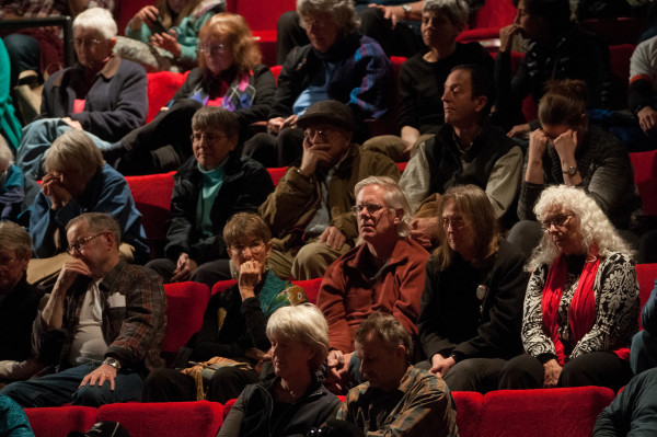 The audience of the day's second public forum on a monument proposed by Roxanne Quimby's family for lands east of Baxter State Park listens at the Collins Center for the Arts on the University of Maine campus in Orono.