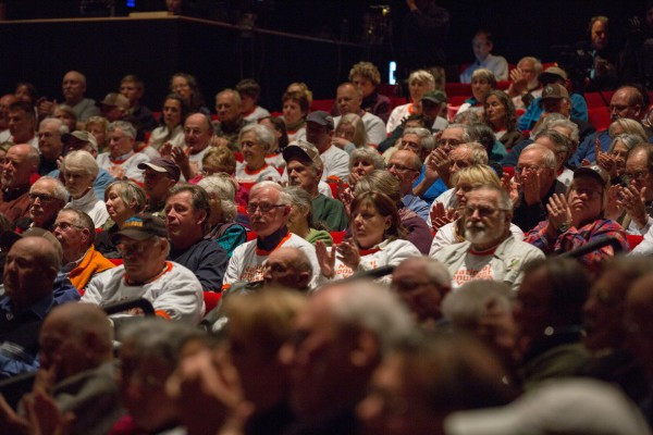 The audience of the day's second public forum on a monument proposed by Roxanne Quimby's family for lands east of Baxter State Park claps for a proponent of the project at the Collins Center for the Arts on the University of Maine campus in Orono.