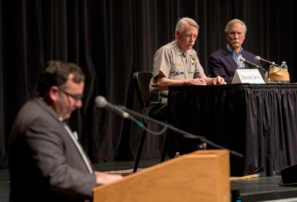 National Park Service Director Jonathan Jarvis and U.S. Sen. Angus King, I-Maine, listen to a LePage representative at the day's second public forum on a monument proposed by Roxanne Quimby's family for lands east of Baxter State Park at the Collins Center for the Arts on the University of Maine campus in Orono.