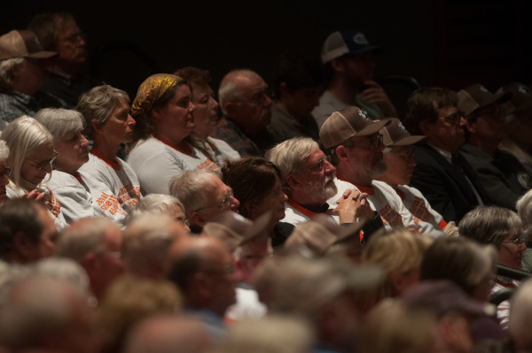 The audience of the day's second public forum on a monument proposed by Roxanne Quimby's family for lands east of Baxter State Park listens to National Park Service Director Jonathan Jarvis speak at the Collins Center for the Arts on the University of Maine campus in Orono.