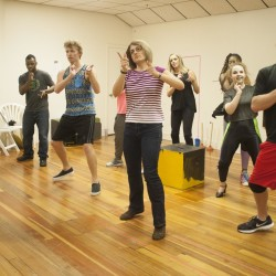 """Director and choreographer Michele Colvin teaches new choreography to the ensemble for Penobscot Theatre's upcoming production of """"Rock of Ages,"""" which will stage June 9 through July 2."""
