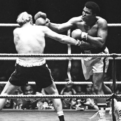 Muhammad Ali (right) punches Richard Dunn while fighting for the WBC/WBA Heavyweight Title in Munich, Germany  on May 24, 1976. Ali died Friday night at age 74.
