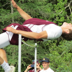Hunter Smith of Foxcroft Academy clears the bar in the high jump during Saturday's Class B track and field state championship meet at Mount Desert Island High School in Bar Harbor. Smith won the event, and the 110 hurdles to spearhead the Ponies to the boys title.