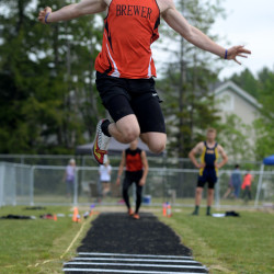 —Brewer's Erick Seekins won the boys long jump with a distance of  21 feet, 5.25 inches during the Class A state track and field championships Saturday at Hampden.