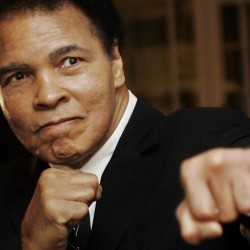 Boxing great Muhammad Ali poses during the Crystal Award ceremony at the World Economic Forum in Davos, Switzerland, Jan. 28, 2006.