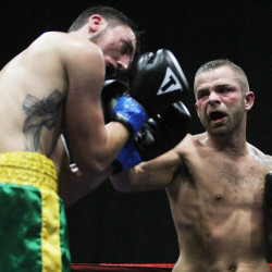 Brandon Berry (right) battles Eric Palmer for the Northeast Junior Welterweight title in Lewiston in this October 2014 file photo.