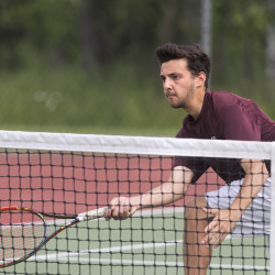 George Stevens Academy's Aidan Byrne makes a return during the No. 1 doubles match against Orono High School during the Class C North championship Tuesday at the University of Maine in Orono.
