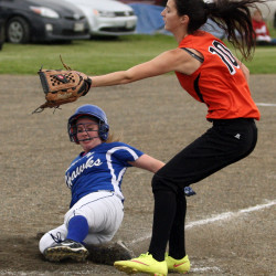Hodgdon sophomore Megan Russell (left) slides safely home as Shead pitcher Taylor Kilby covers the plate during their Class D North preliminary playoff on Tuesday in Hodgdon.