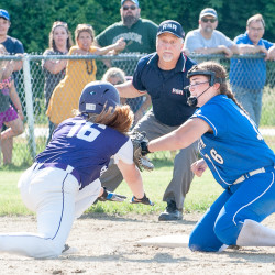 Hampden Academy's Sydney Hatch (left) gets caught off base and tagged out by third baseman Jordan Mynahan during their playoff game on Tuesday in Lewiston.