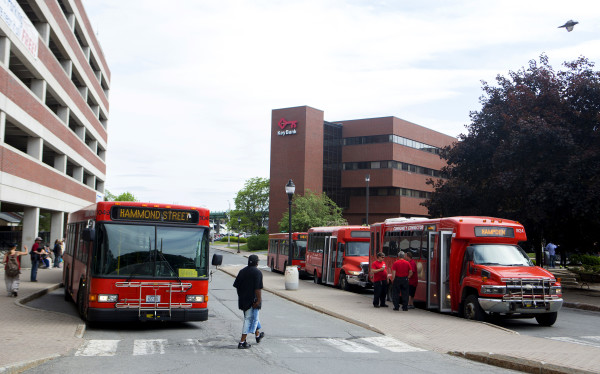 People board buses in Pickering Square in downtown Bangor recently.