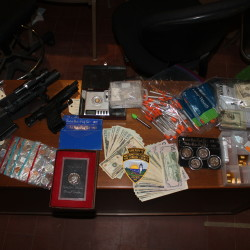 While executing a search warrant in Whiting, authorities seized approximately 22.5 grams of heroin, 125 dosage units of prescription drugs, 1 gram of crack cocaine, $4,637 in cash and five handguns, along with scales and other evidence of trafficking.
