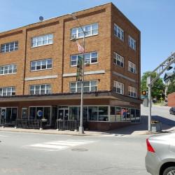 Demolition of six buildings on First Street in Bangor begins