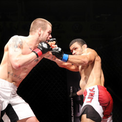 Ryan Sanders (left) of Brewer battles Gil de Freitas of Ludlow, Massachusetts, during a mixed martial arts title bout on the New England Fights XIII card at the Androscoggin Bank Colisee, May 11, 2014.