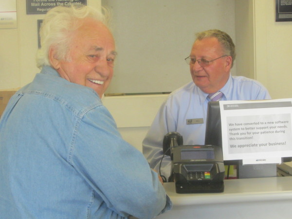 Bill Geary is retiring at the end of the month after 40 years with the U.S. Postal Service. The Rockland Post Office veteran worker is serving customer Thomas Lapointe, who served as city manager for Rockland in the 1960s.