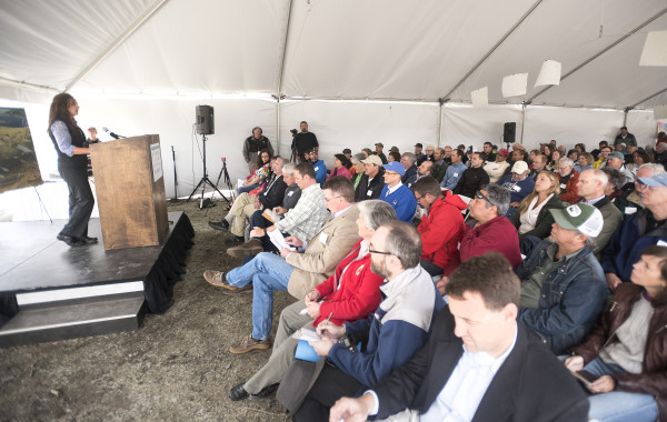 Laura Rose Day (left),  the executive director of the Penobscot River Restoration Project, spaks during the event that marked the completion of the Howland bypass on Tuesday in Howland. It is the last major milestone in the Penobscot River Restoration Project that started over 10 years ago.